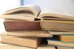 open book on top of stacks - stock photo