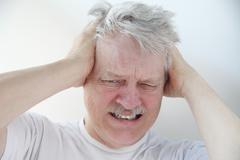 Man with severe headache pain Stock Photos
