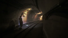 Man in tunnel underground of a mine Stock Footage