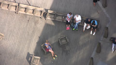 Overhead view of several people sitting in a public area Stock Footage