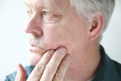 Itchy rash on face of man Stock Photos