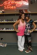 Stock Photo of bai ling and staff melissa corneil.bai ling visits the ed hardy shoe wearhous