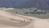 Stock Video Footage of Dune trekkers on ridge
