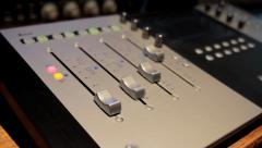 Mixing Desk faders seamless loop automated moving on their own Stock Footage