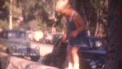 Old Vintage Film 1940s Daring Little Boy Jumps Off Rock Wall Falls Autos Cars Stock Footage