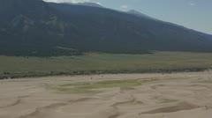 Dune surfer walking up ridge Stock Footage