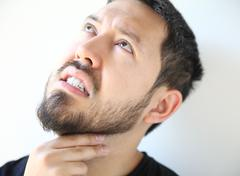 Young man with a sore throat Stock Photos