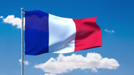 Stock Video Footage of French flag waving over a blue cloudy sky
