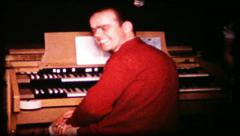 210 man plays organ for hire - vintage film home movie Stock Footage