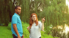 Interracial couple point pointing Stock Footage