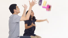 Couples tosses gift box into the air, Bullet time effect Stock Footage