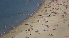 Summer crowd on beach Stock Footage