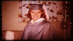215 - the graduate at home before the ceremony - vintage film home movie Stock Footage