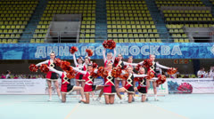 Performance of undefined cheerleaders team with poms Stock Footage