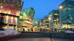 People walk near entrance of Metropolis shopping center Stock Footage