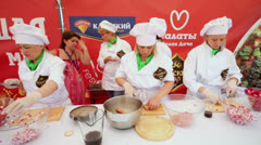 Several cooks cut food in pavilion of Russkii DAR Stock Footage