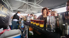 Bartenders and visitors of Carte Noire pavilion Stock Footage