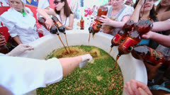 People pour kvass for Guinness Record of biggest okroshka Stock Footage