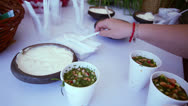 Stock Video Footage of Hand adds souse cream by spoon to russian meal okroshka