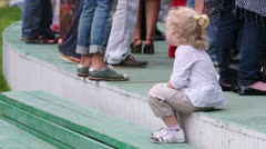 Unidentified child sits on steps at concert of Chaif rock-band Stock Footage