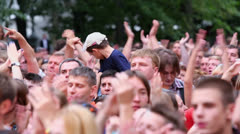 People with kids applaud at concert of Chaif rock-band Stock Footage
