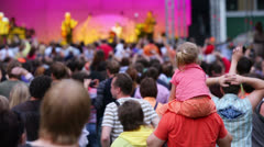 People with kids listen concert of Chaif band Stock Footage