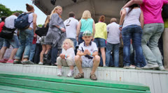 Unidentified children sit and applaud at concert of Chaif Stock Footage