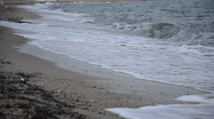 rolling waves on beach just before the sunset in dark dramatic atmosphere - stock footage