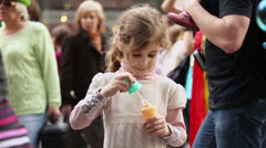 Girl inflates soap bubbles on Parade of bubble of Dreamflash Stock Footage