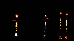 Dark background of candles waving with nice reflection Stock Footage