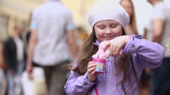 Girl plays with soap bubbles gun during holiday of spring Stock Footage