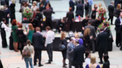 Stock Video Footage of Many people walk by hall and talk near bar, (unfocused)