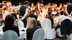 People sit at tables during Ceremony of rewarding of winners Stock Footage