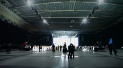 People walk near stage at ceremony of rewarding winners Stock Footage