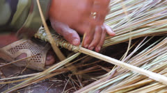 Hands Weaving Thatch Construction Material Stock Footage