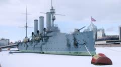 Aurora vessel docked on frozen Nieva River in Sankt Petersburg Stock Footage