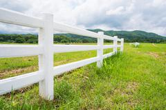 fence in farm field with cloudy - stock photo