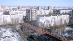 Tall buildings in suburban area in winter during the day Stock Footage