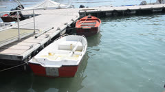 Cove with old fishing boat in water Stock Footage