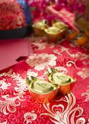 Chinese gold ingot with setups on background Stock Photos