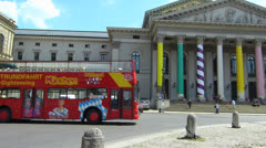 Munich City sightseeing tour bus at National Theater Bavaria Germany Stock Footage