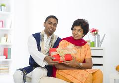 punjabi family mother and son with lifestyle setting - stock photo