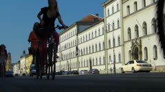 SM Munich city bicycle biker Leopold street Germany Bavaria Stock Footage