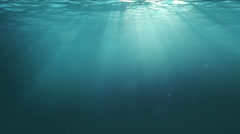 Underwater Scene with Sun rays shining through the water's surface. Stock Footage