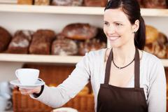 serving coffee in a bakery - stock photo