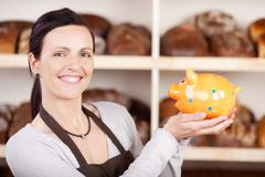 Smiling woman baker Stock Photos