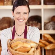 Beautiful female bakery worker Stock Photos