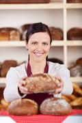 Friendly bakery assistant or worker Stock Photos