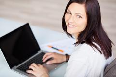 typing businesswoman - stock photo
