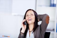 nauraa nainen puhuu puhelimitse - stock photo